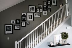Love the layout, black frames, black and white photos, and that green-gray on the walls