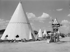 Cabins Imitating the Indian Teepee for tourists along highway south of Bardstown, Kentucky. Photographed by Marion Post Wolcott in July 1940 on medium format b&w negative. Photo shows Wigwam Village #