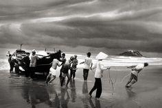 Vietnam, Boat people pulling Boat ashore 1995 gelatin silver print