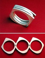 pretty ring that unfolds into makeshift brass knuckles for protection or general badassery