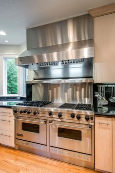 I love this stove i like a more rustic type cabinetry for Dream kitchen appliances