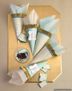 PHOTO: ANITA CALERO Calligraphy Cone Favors The final touches for a gilded theme: Victorian-style paper cones stuffed with wrapped chocolates. Get the Calligraphy Cones Template and How-To Cone Template, Art Template, Wedding Favours, Diy Wedding, Party Favors, Wedding Ideas, Wedding Clip, Wedding Paper, Bar A Bonbon