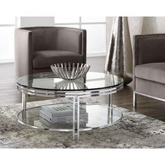 ANDROS COFFEE TABLE: This coffee table from our Ikon collection is de ned by an intriguing art deco- inspired polished steel frame. This piece is sure to add elegance and function with a thick tempered glass top and bottom shelf. Rectangle Glass Coffee Table, Modern Glass Coffee Table, Coffee Table Grey, Cool Coffee Tables, Round Coffee Table, Coffee Table Design, Glass Table, Table Haute, Sofa End Tables
