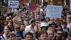 Crowds massed in the US capital and around the world Saturday to support science and evidence-based research -- a protest partly fueled by opposition to President Donald Trump's threats of budget cuts to agencies funding scientists' work.