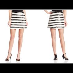MINKPINK striped faux leather skirt Ultra chic striped PU leather skirt by MINKPINK. A-line style. Hidden back zip. Size XS (0-2). 25 inch waist, 15.5 inches long. 50% polyester, 50% PU. Brand new with tags. MINKPINK Skirts A-Line or Full