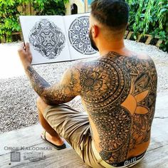 Geometric sleeve and mandala backpiece www.saketattoo.com/orge
