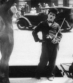 Charlie Chaplin admiring a statue GIF