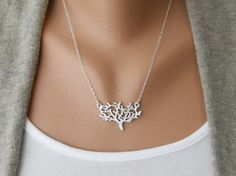 I have this necklace in both silver and gold.  Whenever I wear them I always get compliments.