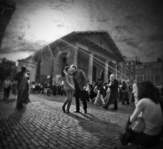 Covent Garden - quirky angle, b/w, lomo-style blur & light shafts,  have elevated a swift reaction shot into a touching expression of love. Which otherwise would have been lost among the crowd. By Sergey Lekomtsev on 500px.