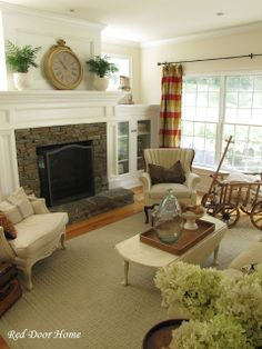 Cabinets under windows on either side of the fireplace to hide tv/dvd components.  TV over the fireplace.
