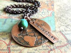 This travel-inspired etched globe necklace is a fun choice for those with wanderlust.