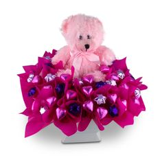 Beary Cute is a sweet gift for any new Mum.  This cute teddy is arranged amongst 50 solid cadbury hearts and stars in a square ceramic pot.   This arrangement comes with a COMPLIMENTARY gift message card.   Next day delivery available to most Sydney Metro and Central Coast areas.   Overnight delivery available to most Blue Mountains, Newcastle and Wollongong Areas.