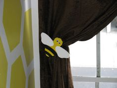 Bumble Bee Nursery - Curtain tie backs. the bumble bees were pre-made wood pieces from Michaels and they were painted to match the nursery.