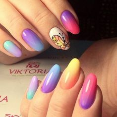 Rainbow Butterfly. This amazing play of colors and the buzzing of butterfly is simple awesome with respect to the spring season. Just merge the rainbow colors along with the accent butterfly on your nails and get spring fashion at hand.