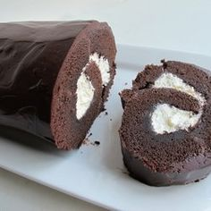 Chocolate Roll (a. Giant Yodel) Dunno what a 'Yodel' is.but my broke self says it LOOKS like a giant Lil Debbie Swiss Cake Roll Yummy Treats, Delicious Desserts, Sweet Treats, Yummy Food, Chocolate Roll Cake, Chocolate Roulade, Giant Chocolate, Cake Recipes, Dessert Recipes