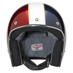 Bonanza LE Racer Helmet —Red/White/Blue • Injection-molded ABS outer shell with hand-painted finish • Expanded polystyrene inner shell • Hand-sewn removable brushed Lycra liner with contrasting diamond-stitched quilted open-cell foam padding • Meets DOT safety standards • Rugged plated steel D-ring neck strap with adjustment strap end retainer • Rubber or chrome accent edging • XS through XXL sizes—$129.95