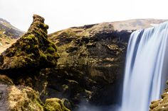 Facerock - Skogafoss waterfall in Iceland with boulder shaped like a face