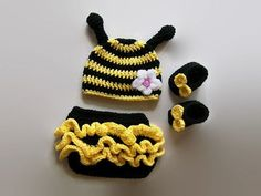 Baby Bumble Bee   She will be the cutest little bumble bee in the neighborhood. This adorable little outfit is made with quality and soft yarn for baby's comfort. Set comes with everything seen in the picture. Different color flower maybe, absolutely just leave me a little note upon ordering and it will done your way.  size Newborn, 0-3 Months, 3-6 Months, 6-9 Months, 9-12 Months