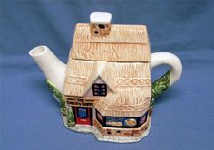 Could the teapot I have 'Antique Store' be an Andrea by Sadek teapot??? ANDREA BY SADEK  SMALL VILLAGE BAKER'S SHOPPE STORE TEAPOT