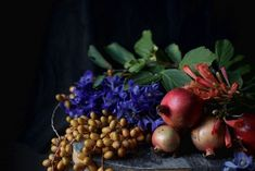 Gardenista; Belgian Masters' Inspired Floral DIY; fall flowers; pomegranate; delphinium; dates