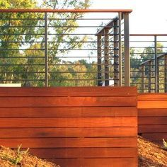I like this deck skirting. Instead of metal, I'd use horizontal wood for the railing, too, but skinnier wood and with wider spaces between slats than the skirting.