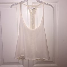 Low Back Chiffon & Lace Tank Cute & Stylish Cream Colored Tank! Chiffon Material on the Front & Lace on the back! Looks adorable paired with a cute bandeau underneath! Never Worn Garage Tops Tank Tops