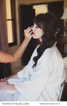 Bride getting ready   Photography: Kim du Toit
