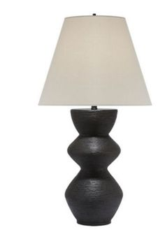 KELLY WEARSTLER | UTOPIA TABLE LAMP. Carved aged iron base juxtaposed with a linen shade.