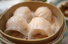 This is har gao, the guilty pleasure of anyone who has ever tried dim sum. Simple, translucent dumplings, filled with shrimp and minced bamboo shoots.