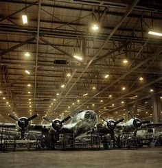 """Flying Fortress' 1942 December 1942, a year after Pearl Harbor. """"Production. B-17 heavy bomber. A nearly complete B-17F 'Flying Fortress' at Boeing's Seattle, Washington plant."""" Photo by Andreas Feininger for the Office of War Information. 3,405 were built: 2,300 by Boeing, 605 by Douglas, and 500 by Lockheed (Vega). These included the famous Memphis Belle. 19 were transferred to the RAF, where they served with RAF Coastal Command as the Fortress II."""