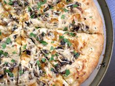 Caramelized Onion & Mushroom White Pizza-Made tonight minus mushrooms plus bacon. Yum and a half!