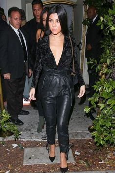 Kourtney Kardashian wearing Gianvito Rossi Ellipsis Pumps, Gucci Marmont Bag, Mystylemode Black Crushed Velvet Plunging V Neck Long Sleeve Bodysuit and Philosophy Di Lorenzo Serafini High Waist Pleated Patent Leather Pants