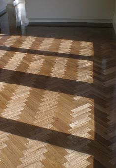 Australian hardwoods are very well suited to parquetry.  This floor is Tallowwood.