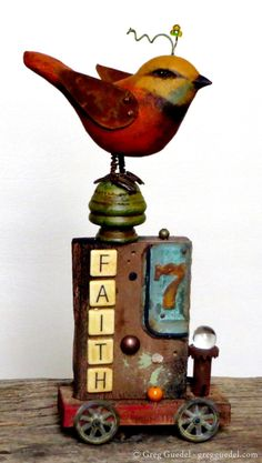 Folk art assemblage piece by Greg Guedel. Hand carved bird, rusty tin and found objects