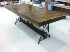 #Kitchen, #PalletTable, #RecyclingWoodPallets I have always wanted to build a pallet trestle table, so I did it. I had an old singer sewing machine base in the shop; I decided to incorporate it into my table. The result was amazing!
