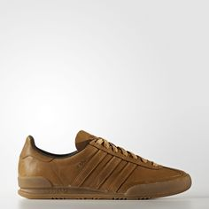 """Originally designed to look good with jeans, these sleek, low-profile sneakers went off the market in the '80s, so they became a much sought-after classic.  A favourite of football fans, these Jeans sneakers feature a premium all-leather lining and T-toe overlay upper. Built with a solid allover colour from the laces to the Trefoil logo pattern outsole, these streamlined shoes feature gold foil printed """"Jeans"""" by the serrated 3-Stripes."""