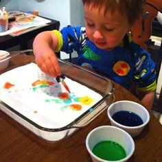 """This kept my 2-year-old busy for an entire hour and my 4-year-old busy for 2 hours! YAY! Drop vinegar tinted with food coloring onto a pan filled with baking soda. Sheer minutes of colorful fizziness!"