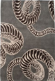 KELLY WEARSTLER | SERPENT RUG. The thick black contrast found in serpent's signature pattern is depicted in rich hand knotted wool, giving a luxurious variation of light and dark.