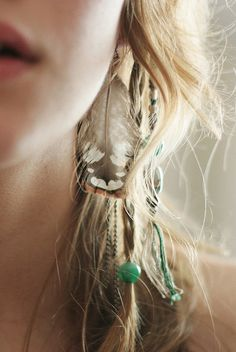 feathers in hair.