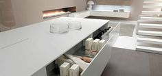 Use Corian to match your designer kitchen.  Works great with the Cucina Colore range from Mereway Kitchens