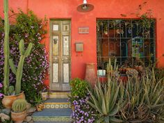 tiles, punched tin doors, wrought iron, adobe, mailbox, potted cactus, bright colors.  Love it ALL!