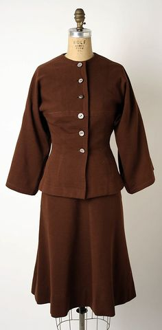 Manufacturer:     Townley Frocks (American) Date:     1942 Culture:     American Medium:     wool, cotton