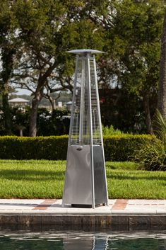The patented Stainless Steel Pyramid Flame Heater brings a new dimension to outdoor heating. This stylish unit provides a uniquely visual flame while providing heat in every direction, and will be the focal point of any outdoor setting. Ignition System, Patio Heater, Outdoor Settings, Backyard, The Unit, Stainless Steel, Fire, Oasis, Tables