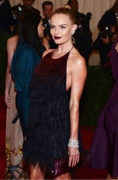 Kate Bosworth look ravishing in at the 2012 Meta Gala in a feathery black halter gown, oxblood lip and ballerina bun