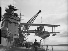 HMS Rodney lowering her Walrus seaplane, 1940 Photographer R. Coote Source Imperial War Museum Identification Code A 193 Amphibious Aircraft, Ww2 Aircraft, Aircraft Carrier, Heavy Cruiser, Merchant Navy, Flying Boat, Royal Marines, Navy Ships, Royal Navy