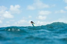 Justine Mauvin​ disappearing into the blue #ROXYsurf