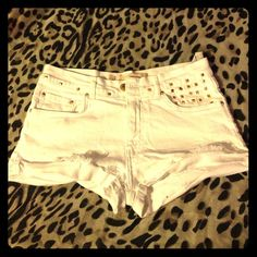 ZARA White Studded Shorts. Never worn. White distressed denim shorts with gold toned pyramidal studs. Casual but glam! Zara Jeans