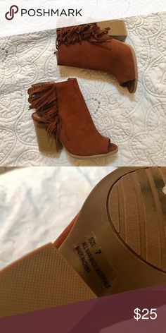 Fringe heels SUPER cute fringe heels. Only worn once. There's a couple small little marks on the shoes but I'm pretty sure those would be easily removed, other than that these are super comfy and in great condition. Size 7 Shoes Heeled Boots