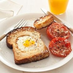 egg in a hole with broiled tomatoes