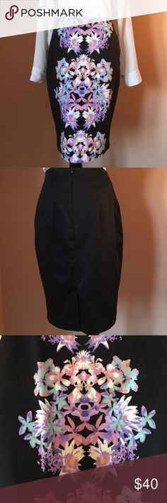 Mirror Image Pencil Skirt This fully lined black skirt has pink, purple and teal (floral looking) mirror image down front. Two hidden side pockets at top front of skirt and zipper in the back. Reasonable offers always considered. Over a 120 items listed, bundle to save more! 13-16-18-12-00-30 Moschino Skirts Pencil
